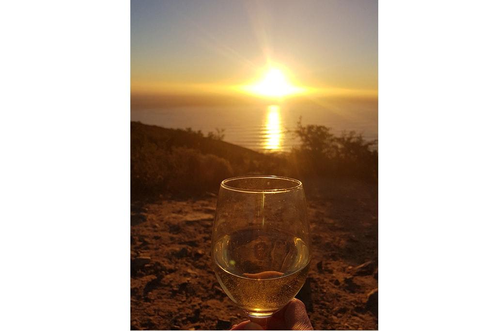 Sunset en Signal Hill con copa de champagne